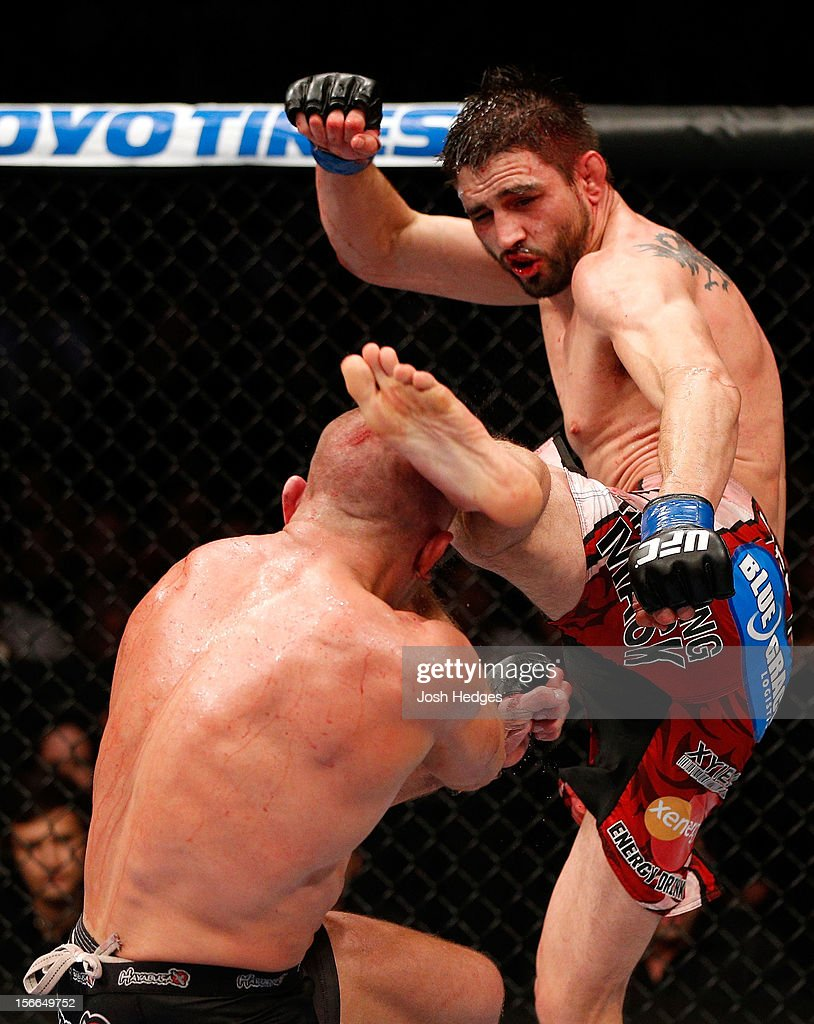 Carlos Condit lands a left footed kick to the head of Georges St-Pierre in their welterweight title bout during UFC 154 on November 17, 2012 at the Bell Centre in Montreal, Canada.