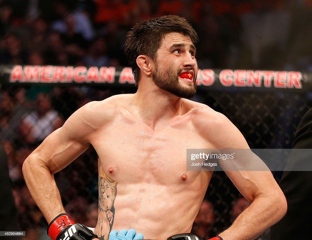 Carlos Condit looks in disbelief after being defeated by Tyron Woodley by TKO in their welterweight bout at UFC 171 inside American Airlines Center...