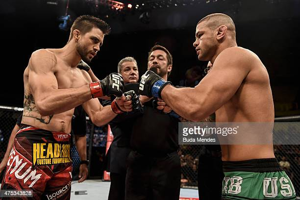 Carlos Condit of the United States and Thiago Alves of Brazil touch gloves prior to their welterweight UFC bout during the UFC Fight Night event at...