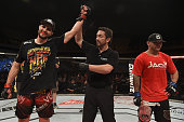 Carlos Condit of the United States celebrates victory over Thiago Alves of Brazil in their welterweight UFC bout during the UFC Fight Night event at...