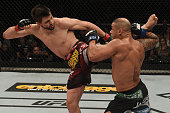 Carlos Condit of the United States kicks Thiago Alves of Brazil in their welterweight UFC bout during the UFC Fight Night event at Arena Goiania on...