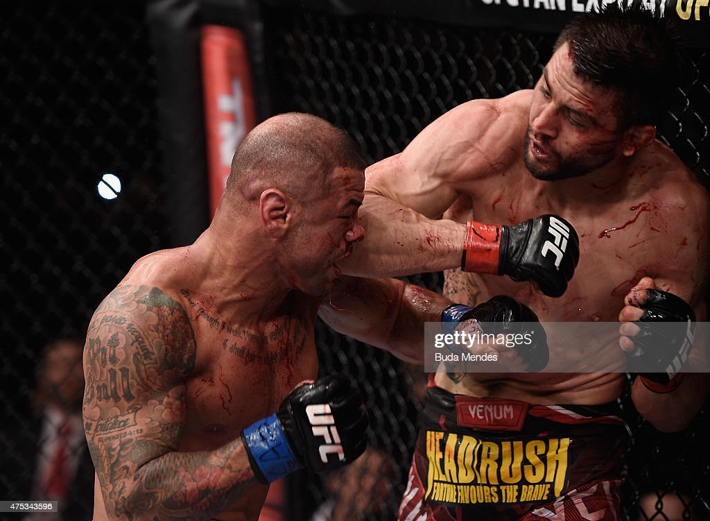 Carlos Condit of the United States punches Thiago Alves of Brazil in their welterweight UFC bout during the UFC Fight Night event at Arena Goiania on...