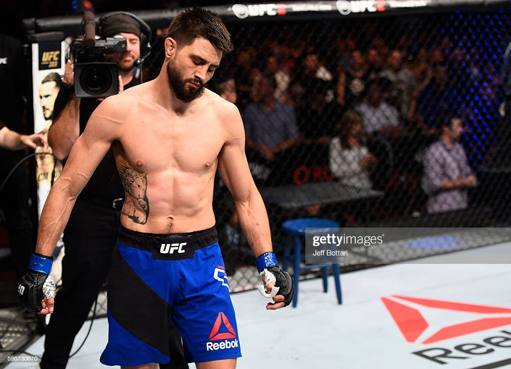 http://media.gettyimages.com/photos/carlos-condit-of-the-united-states-reacts-to-his-submission-loss-to-picture-id596730670?k=6&m=596730670&s=594x594&w=0&h=kla1MFeNW9-o2DpUjcLfierzPHDOOUKIwVH9AdtEouk=