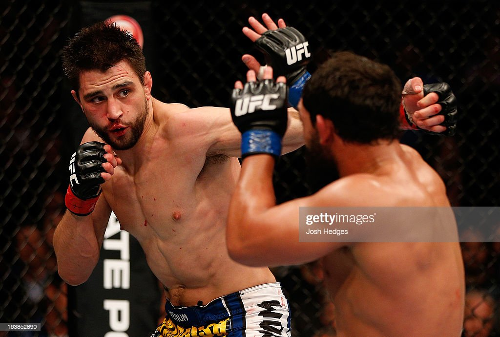 Carlos Condit punches Johny Hendricks in their welterweight bout during the UFC 158 event at Bell Centre on March 16 2013 in Montreal Quebec Canada