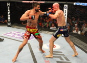 Carlos Condit punches Martin Kampmann in their welterweight fight during the UFC on FOX Sports 1 event at Bankers Life Fieldhouse on August 28 2013...