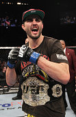 Carlos Condit reacts after defeating Nick Diaz by decision to win the Interim UFC Welterweight Championship during the UFC 143 event at Mandalay Bay...