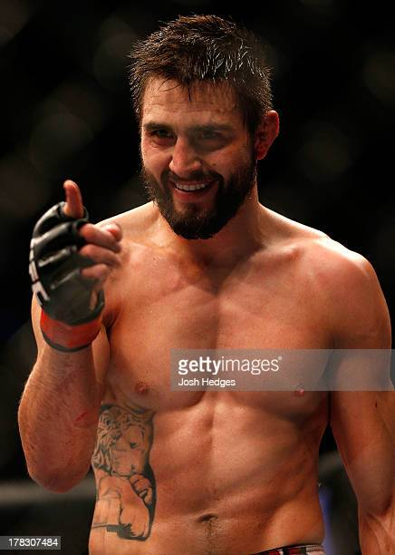 Carlos Condit reacts after knocking out Martin Kampmann in their welterweight fight during the UFC on FOX Sports 1 event at Bankers Life Fieldhouse...