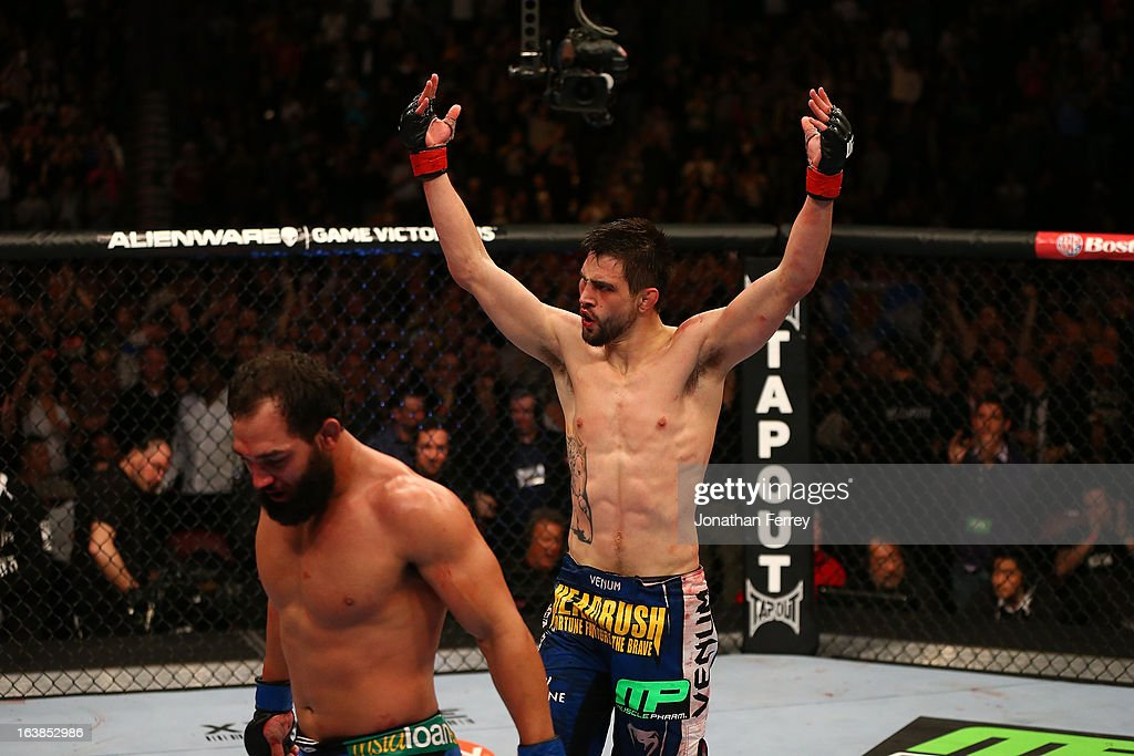 Carlos Condit reacts after the conclusion of his welterweight bout against Johny Hendricks during the UFC 158 event at Bell Centre on March 16, 2013 in Montreal, Quebec, Canada.