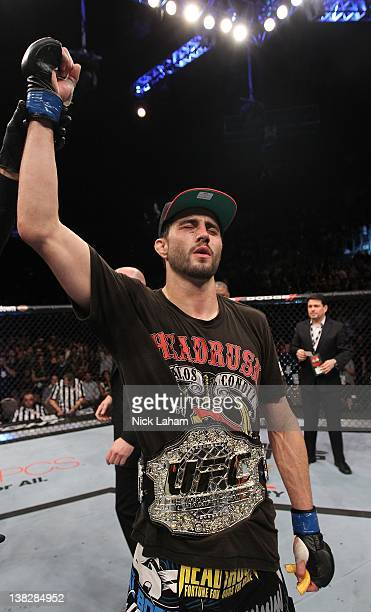 Carlos Condit receives the interim UFC welterweight championship belt after defeating Nick Diaz during the UFC 143 event at Mandalay Bay Events...
