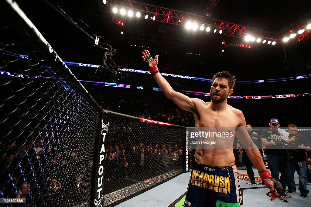 Carlos Condit salutes the crowd after his three round battle against Johny Hendricks during the UFC 158 event at Bell Centre on March 16, 2013 in Montreal, Quebec, Canada.