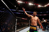 Carlos Condit salutes the crowd after his three round battle against Johny Hendricks during the UFC 158 event at Bell Centre on March 16 2013 in...