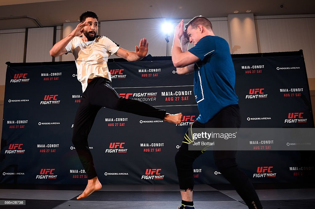 Carlos Condit throws a kick towards trainer Ricky Lundell during an open workout session for media and fans at the Hyatt Regency Vancouver on August...