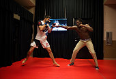 Carlos Condit warms up with teammate Jon Jones backstage during the UFC 195 event inside MGM Grand Garden Arena on January 2 2016 in Las Vegas Nevada