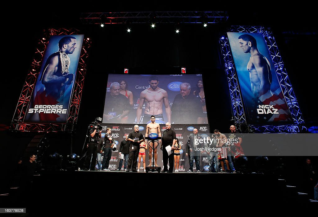 <a gi-track='captionPersonalityLinkClicked' href=/galleries/search?phrase=Carlos+Condit&family=editorial&specificpeople=7049007 ng-click='$event.stopPropagation()'>Carlos Condit</a> weighs in during the UFC 158 weigh-in at Bell Centre on March 15, 2013 in Montreal, Quebec, Canada.