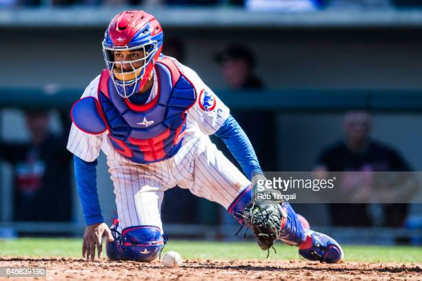 Carlos Corporan of the Chicago Cubs defends his position during a spring training game against the Cleveland Indians at Sloan Park on February 26...