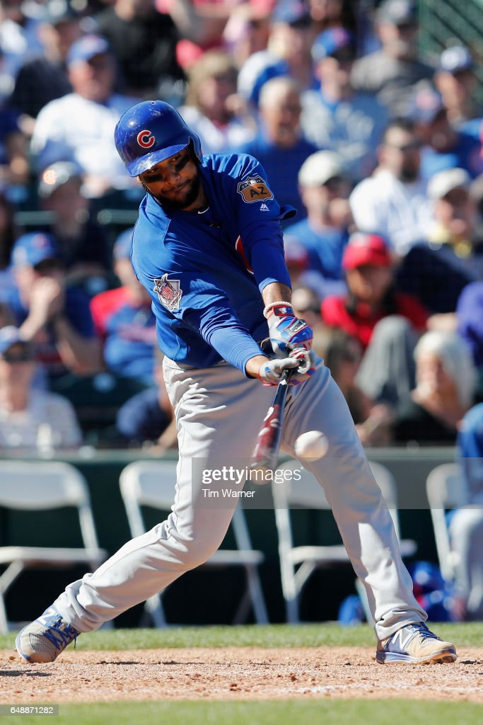 Carlos Corporan #13 of the Chicago Cubs hits an RBI single in the fourth inning against the Los Angeles Angels during the spring training game at Tempe Diablo Stadium on March 6, 2017 in Tempe, Arizona.