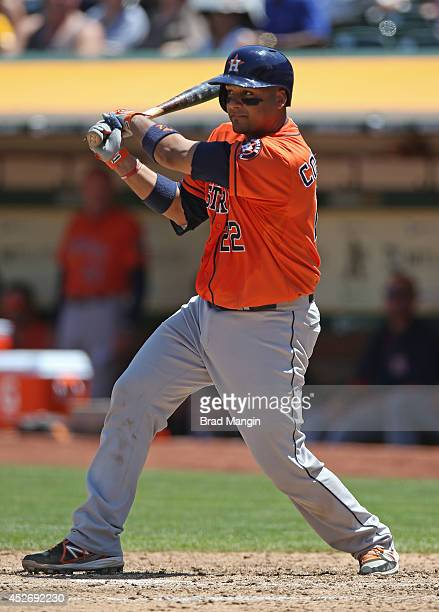 Carlos Corporan of the Houston Astros bats against the Oakland Athletics during the game at Oco Coliseum on Thursday July 24 2014 in Oakland...