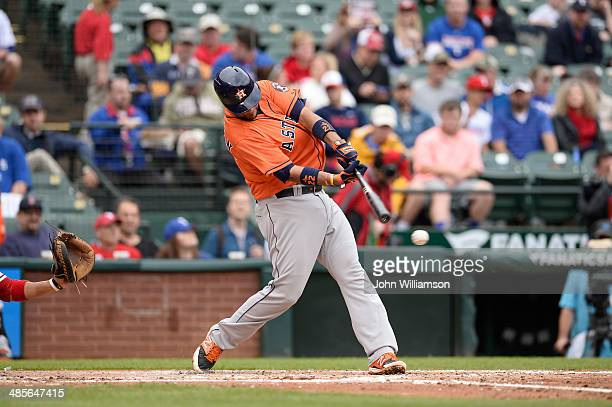 Carlos Corporan of the Houston Astros bats against the Texas Rangers at Globe Life Park in Arlington on April 13 2014 in Arlington Texas The Texas...