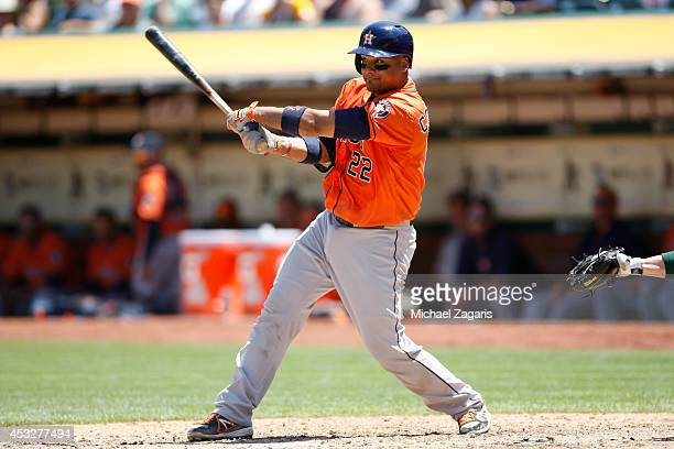 Carlos Corporan of the Houston Astros bats during the game against the Oakland Athletics at Oco Coliseum on July 24 2014 in Oakland California The...