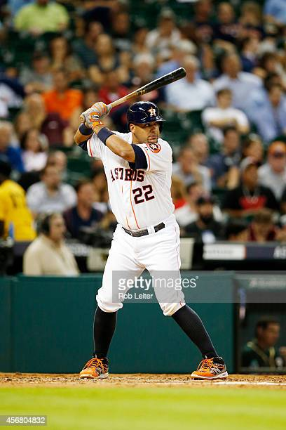 Carlos Corporan of the Houston Astros bats during the game against the Oakland Athletics at Minute Maid Park on August 27 2014 in Houston Texas The...
