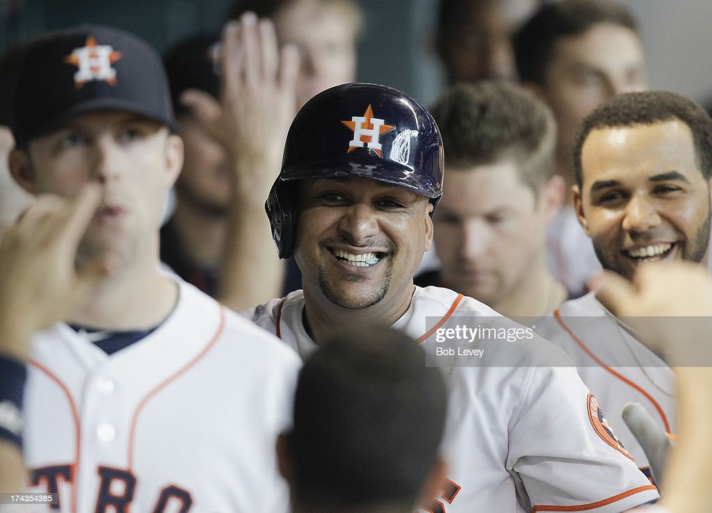 <a gi-track='captionPersonalityLinkClicked' href=/galleries/search?phrase=Carlos+Corporan&family=editorial&specificpeople=5716887 ng-click='$event.stopPropagation()'>Carlos Corporan</a> #22 of the Houston Astros celebrates after hitting a two-run home run in the sixth inning against the Oakland Athletics at Minute Maid Park on July 24, 2013 in Houston, Texas.
