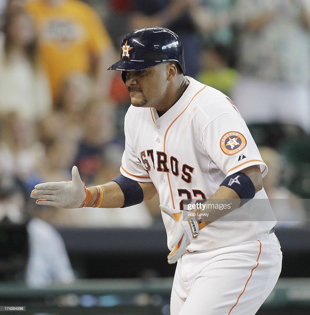 Carlos Corporan #22 of the Houston Astros celebrates after hitting a two-run home run in the sixth inning against the Oakland Athletics at Minute Maid Park on July 24, 2013 in Houston, Texas.