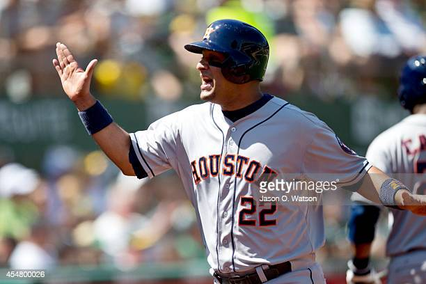 Carlos Corporan of the Houston Astros celebrates after scoring a run against the Oakland Athletics during the sixth inning at Oco Coliseum on...
