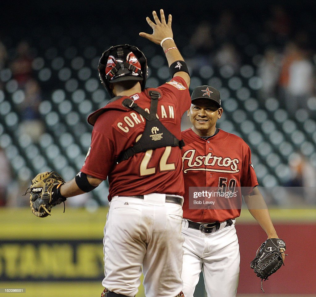 <a gi-track='captionPersonalityLinkClicked' href=/galleries/search?phrase=Carlos+Corporan&family=editorial&specificpeople=5716887 ng-click='$event.stopPropagation()'>Carlos Corporan</a> #22 of the Houston Astros high fives <a gi-track='captionPersonalityLinkClicked' href=/galleries/search?phrase=Wilton+Lopez&family=editorial&specificpeople=4901786 ng-click='$event.stopPropagation()'>Wilton Lopez</a> #59 of the Houston Astros after the final out of the game against the Philadelphia Phillies at Minute Maid Park on September 16, 2012 in Houston, Texas. Houston wins 7-6.
