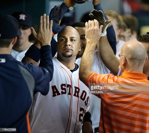 Carlos Corporan of the Houston Astros hits a home run to right field against the Texas Rangers in the eighth inning at Minute Maid Park on August 12...