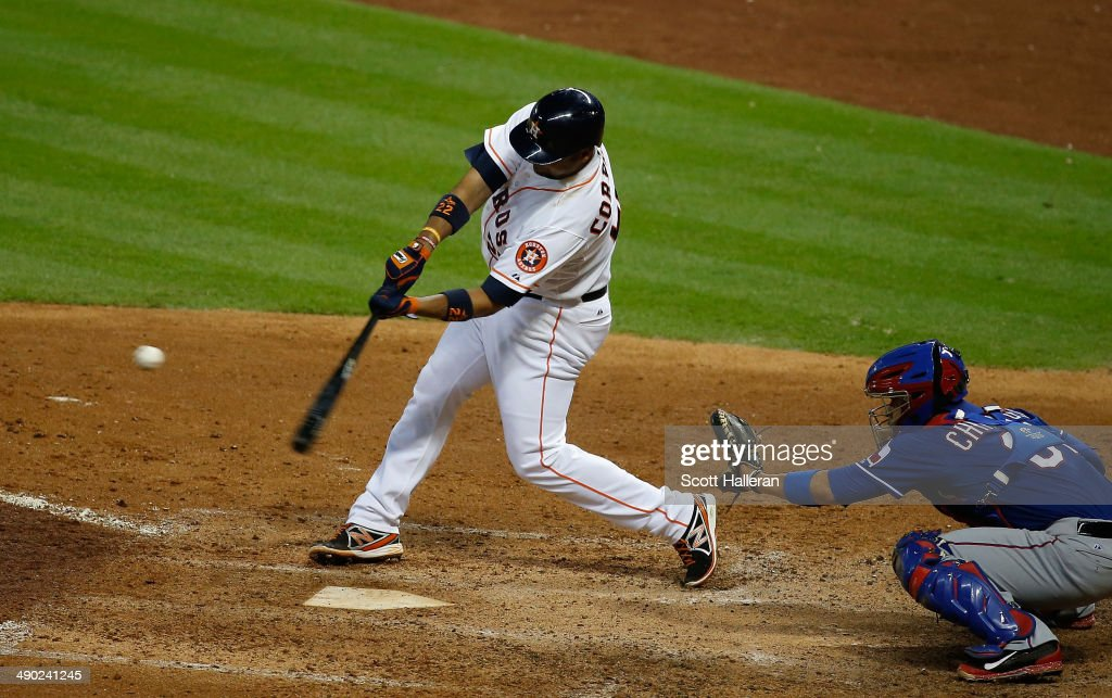 Carlos Corporan #22 of the Houston Astros hits a three-run home run in the fifth inning of their game against the Texas Rangers at Minute Maid Park on May 13, 2014 in Houston, Texas.