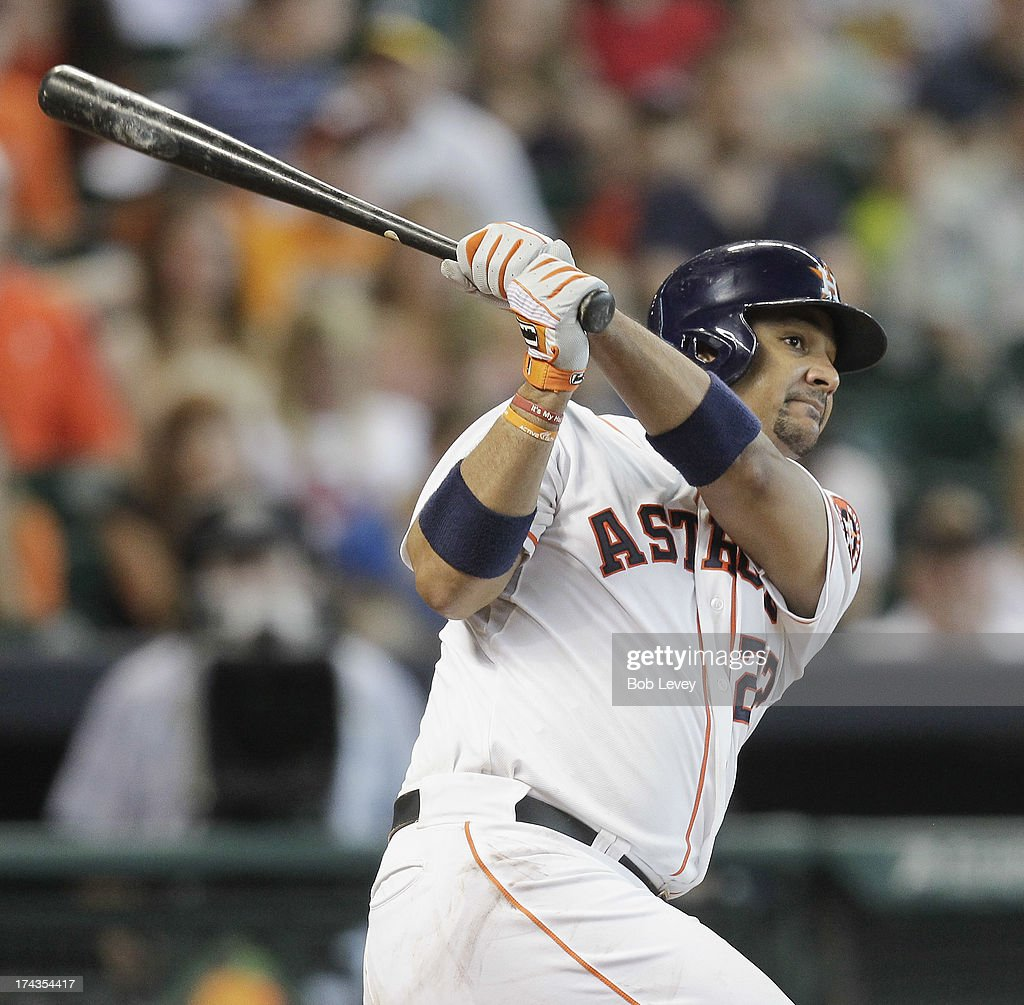 Carlos Corporan #22 of the Houston Astros hits a two-run home run in the sixth inning against the Oakland Athletics at Minute Maid Park on July 24, 2013 in Houston, Texas.