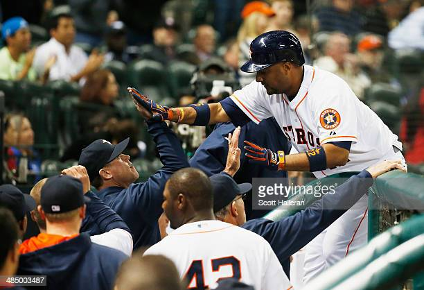 Carlos Corporan of the Houston Astros is greeted by his teammates after hitting a home run in the fifth inning against the Kansas City Royals at...