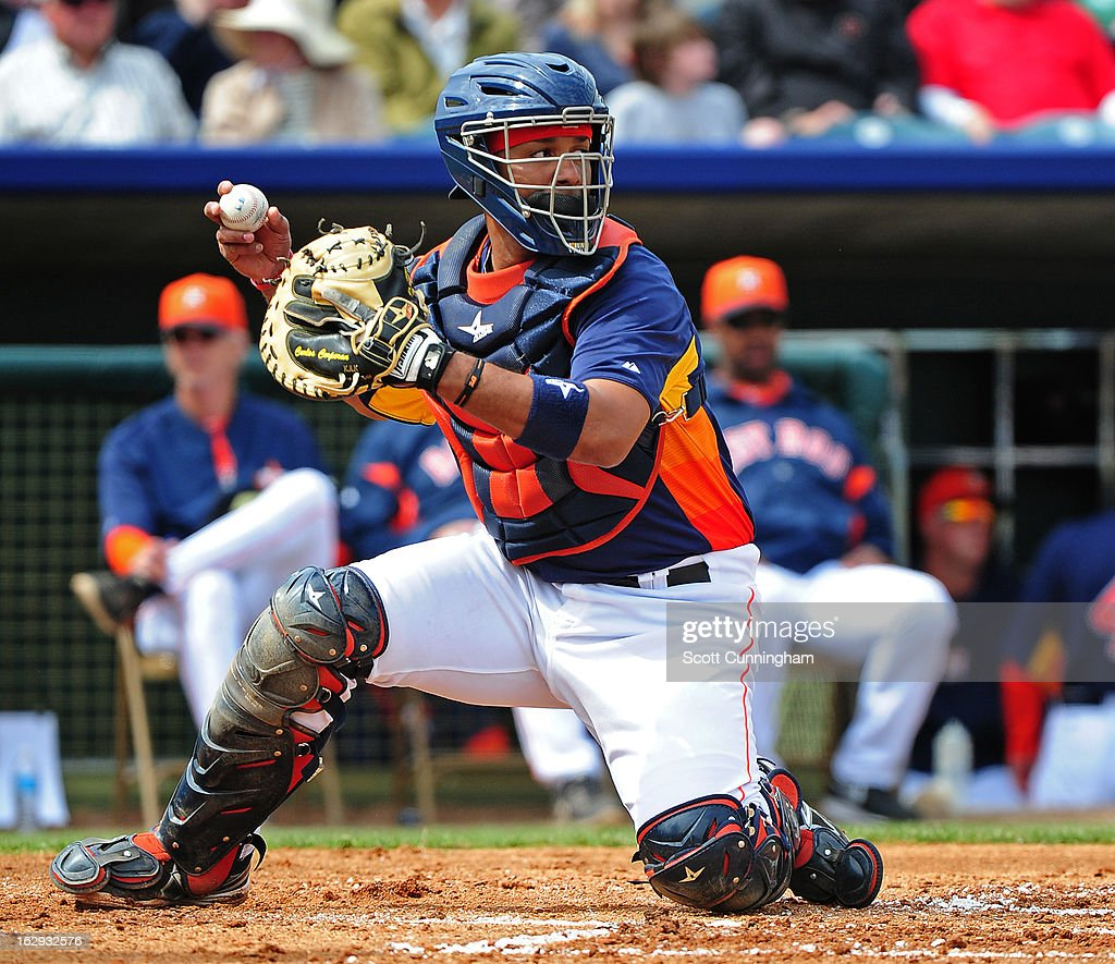 <a gi-track='captionPersonalityLinkClicked' href=/galleries/search?phrase=Carlos+Corporan&family=editorial&specificpeople=5716887 ng-click='$event.stopPropagation()'>Carlos Corporan</a> #22 of the Houston Astros makes a throw against the St. Louis Cardinals during a spring training game at Osceola County Stadium on March 1, 2013 in Kissimmee, Florida.