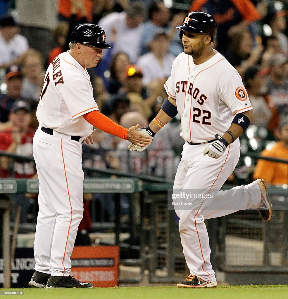 Carlos Corporan #22 of the Houston Astros receives congratuations from Dave Trembley #47 of the Houston Astros after hitting a home run in he seventh inning against the Detroit Tigers at Minute Maid Park on May 4, 2013 in Houston, Texas.
