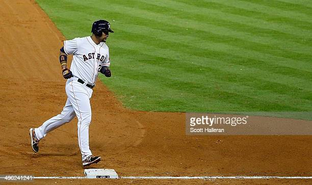Carlos Corporan of the Houston Astros rounds third base after hitting a threerun home run in the fifth inning of their game against the Texas Rangers...