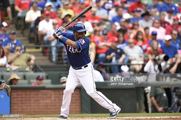 Carlos Corporan of the Texas Rangers bats against the Houston Astros at Globe Life Park in Arlington on April 12 2015 in Arlington Texas The Houston...
