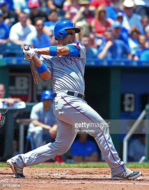 Carlos Corporan of the Texas Rangers bats in the second inning of a game against the Kansas City Royals at Kauffman Stadium on June 6 2015 in Kansas...
