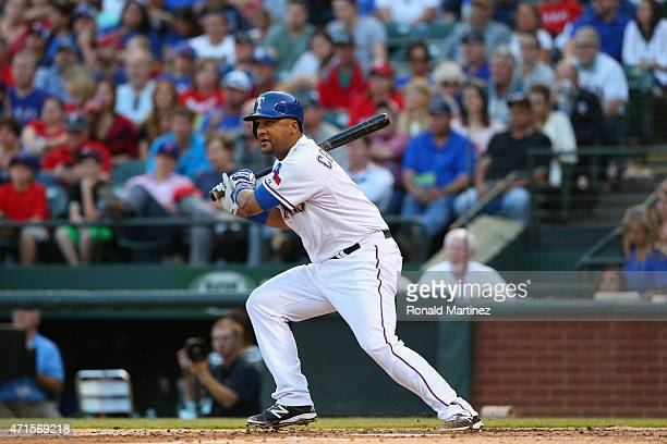 Carlos Corporan of the Texas Rangers hits a rbi single against the Seattle Mariners in the second inning at Globe Life Park in Arlington on April 29...