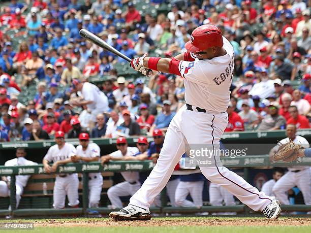 Carlos Corporan of the Texas Rangers hits in the second inning against the Kansas City Royals at Globe Life Park in Arlington on May 14 2015 in...