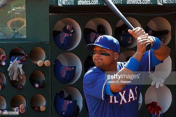 Carlos Corporan of the Texas Rangers stands in the dugout before the game against the Oakland Athletics at Oco Coliseum on April 9 2015 in Oakland...