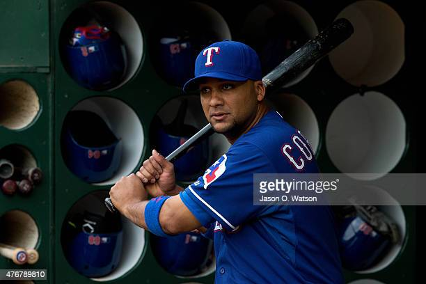 Carlos Corporan of the Texas Rangers stands in the dugout before the game against the Oakland Athletics at Oco Coliseum on June 10 2015 in Oakland...