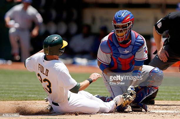 Carlos Corporan of the Texas Rangers tags out Sam Fuld of the Oakland Athletics as he tries to score from third base on a flyout hit by Josh Reddick...
