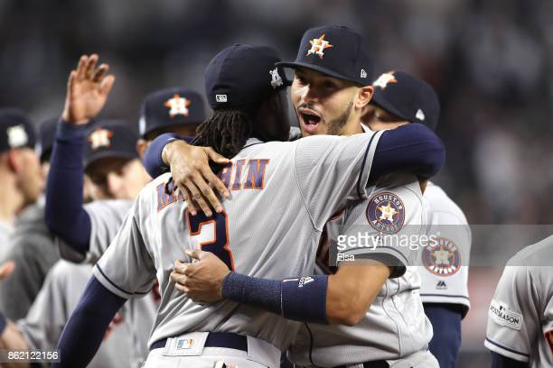Carlos Correa and Cameron Maybin of the Houston Astros react during introductions before Game Three of the American League Championship Series...