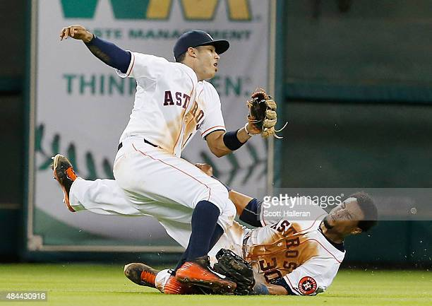 Carlos Correa and Carlos Gomez of the Houston Astros collide in center field in the seventh inning during their game against the Tampa Bay Rays at...