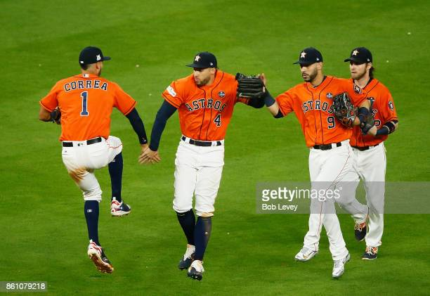 Carlos Correa and George Springer and Marwin Gonzalez of the Houston Astros celebrate their 2 to 1 win over the New York Yankees during game one of...