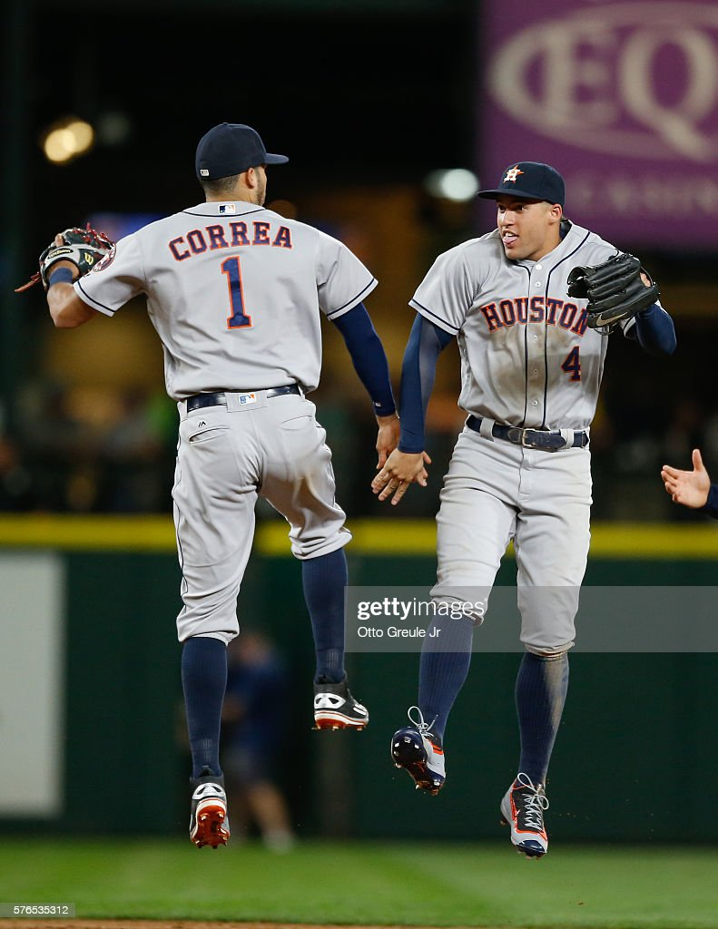 Carlos Correa #1 and George Springer #4 of the Houston Astros celebrate after defeating the Seattle Mariners 7-3 at Safeco Field on July 15, 2016 in Seattle, Washington.
