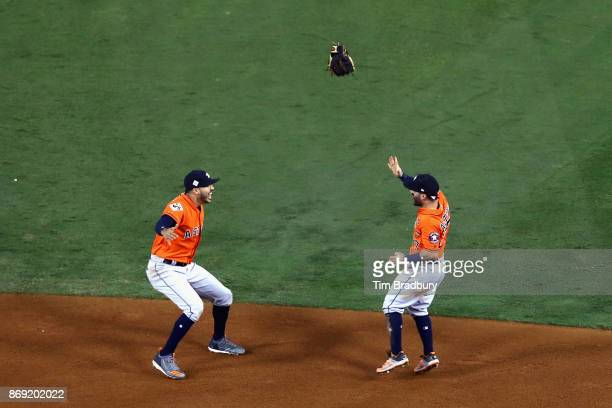 Carlos Correa and Jose Altuve of the Houston Astros celebrate defeating the Los Angeles Dodgers 51 in game seven to win the 2017 World Series at...