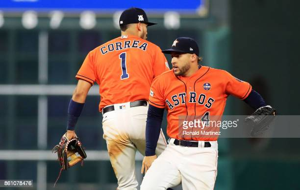 Carlos Correa and Lance McCullers Jr #43 of the Houston Astros celebrate their 2 to 1 win over the New York Yankees during game one of the American...
