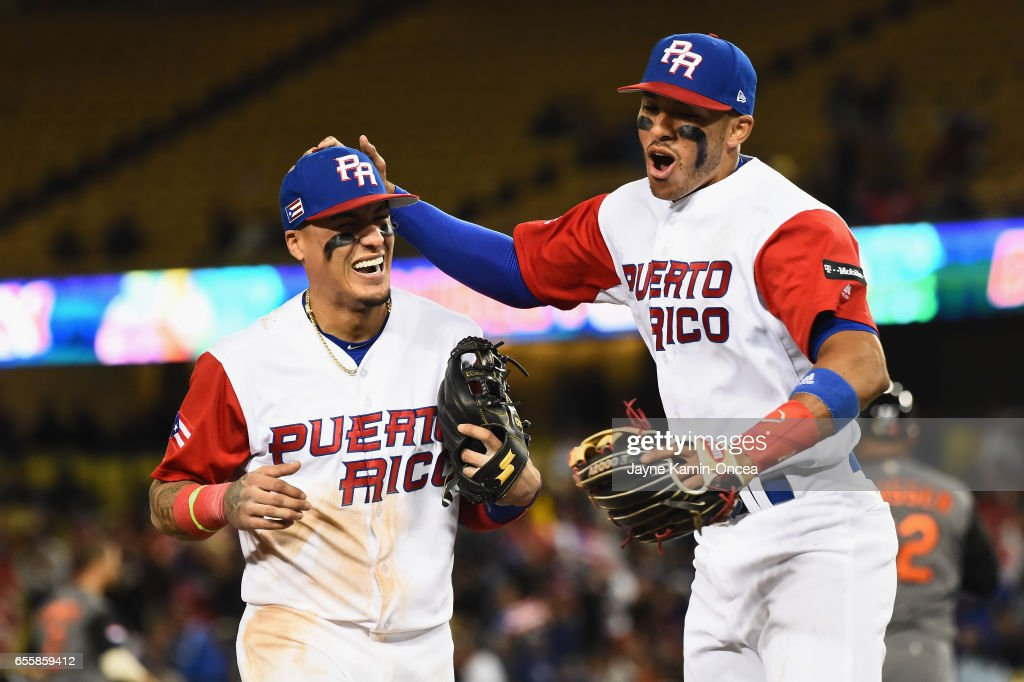 Carlos Correa #1 and T.J. Rivera #5 of the Puerto Rico after a double play to end the ninth inning against team Netherlands during Game 1 of the Championship Round of the 2017 World Baseball Classic at Dodger Stadium on March 20, 2017 in Los Angeles, California.