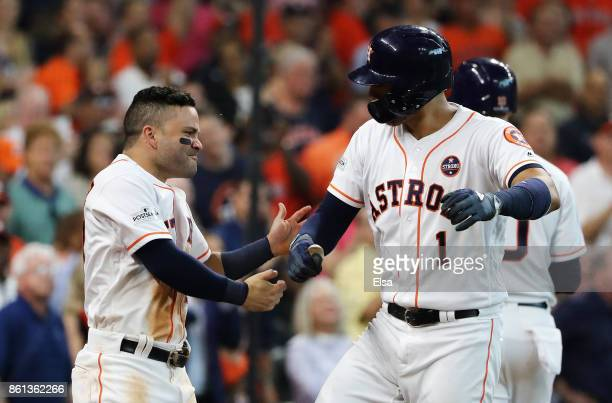 Carlos Correa celebrates with Jose Altuve of the Houston Astros after hitting a homerun in the fourth inning against the New York Yankees during game...